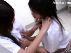 many young schoolgirls giving a kiss rubbing