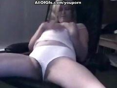 golden-haired playgirl masturbates on the chair