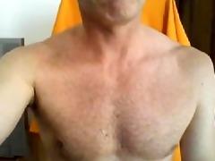 brawny dad showing off