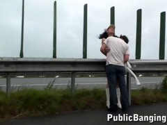 young pair on a freeway in the rain part 0