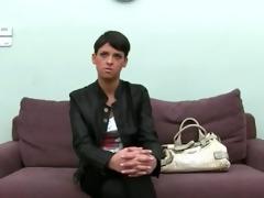 brunette hair girl teasing on old sofa