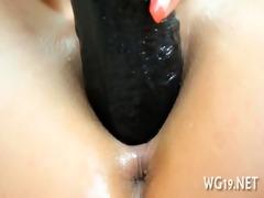 girl positions & masturbates